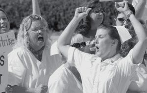 Nancy Newsome, R.N., right, rallied striking nurses from Appalachian Regional Healthcare - Beckley at the State Capitol in Charleston, W.Va., on Monday. The woman on the left is not identified. (AP Photo/Bob Bird)