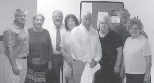 BAPTISM -  The Howards gathered for the baptism of their brother, Hubert Howard. Pictured are (left to right) Charles Howard, Oma Hatton, Jack Howard, Louise Shepherd, Hubert Howard, Betty Tyree, Hillard Howard, and Kathleen Brock.