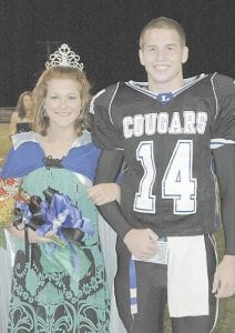 HOMECOMING QUEEN 2007 -  Char-leigh Craft (left) was crowned as Letcher County Central High School's homecoming queen on October 11 during half-time of a football game between the Letcher Central and East Ridge High School. Miss Craft, daughter of Harold and Judy Craft of Sandlick, was escorted by Charlie Banks, son of Steve and Tommie Banks, also of Sandlick. (Photo by Lonnie Sexton)