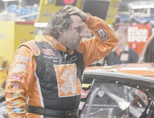 Tony Stewart, pictured last week at Lowe's Motor Speedway, might be the most talented driver in NASCAR, but his raw emotion has likely cost him a shot at a third Nextel Cup title. (AP Photo/Terry Renna)