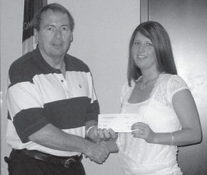 DONATIONS -  Danny S. Maggard, chief engineer of Kentucky River Properties LLC, is pictured above with Britanie Sturgill of Letcher Manor Nursing Home. Below, Maggard is pictured with representatives of area fire departments. Kentucky River Properties LLC donates annually to Letcher Manor and other nursing homes in the surrounding areas, and to fire departments in Letcher County and the surrounding areas. Pictured below are (left to right, back row) Terry P. Caudill, Mayking Fire Department; Gary Rogers, Letcher Fire Department; Larry Jones, Gordon Fire Department; Danny S. Maggard; (front row) Robert Meade, Kingscreek Fire Department; and Buddy Sexton, Sandlick Fire Department.