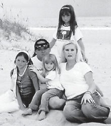 ANNIVERSARY -  Joe and Marie Pratt of Craft's Colly celebrated their eighth wedding anniversary on Sept. 26. They celebrated with the Pratt family at a reunion at Cape Hatteras, N.C. Pictured with them are their children, Kayla, 13; Taylor, 7 1/2; and Trinity 3 1/2.