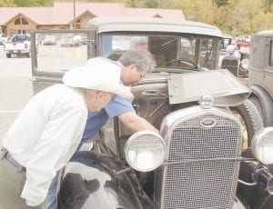 When Morris Maggard, left, was told that the owners of as many as 20 Ford Model A cars would be stopping by the Pine Mountain Grill in Whitesburg for lunch last Friday, he dropped by to