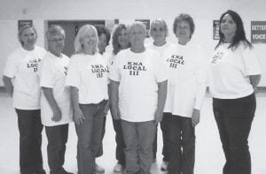 NURSES' UNION -  On Oct. 17, members of local Kentucky Nurses Association Unit 111 traveled to Louisville to attend a special labor discussion and rally given by the national AFL-CIO organization with guest speaker Stewart Acuff. Pictured are (left to right) Belinda Sexton, Joan Ramsey, Rene Campbell, Kim Lucas, Madonna Pennington, Debbie Pennington, Missy Lucas, Anita Branham, and Patty Fields.