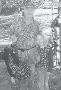 TURKEY HUNTER -  Glenn Brown of Whitesburg, recently celebrated his 79th birthday by killing his first turkey with a bow and arrow. He is an active member of the Little Shepherd Chapter of the National Wild Turkey Federation. Pictured with him is his great-granddaughter, Anna Bledsoe. She is the daughter of Janis Campbell Marr of Elizabethtown, and Brandon Bledsoe of Big Stone Gap, Va.