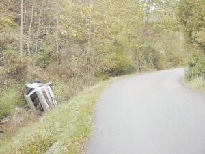 OFF-ROAD VEHICLE -  This vehicle remained on its side in Thornton Creek for several days last week after it left the pavement in a blind curve on Highway 1862. (Eagle photo)