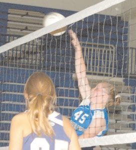 Letcher County Central High School volleyball star Heather Hatton (45) connects on a spike to help lead the Lady Cougars to a regional tournament win over Hazard. Hatton was named the tournament's most valuable player. Letcher Central advances to state tournament play this week at Northern Kentucky University in Highland Heights. The Lady Cougars are scheduled to play Greenwood High School at 1 p.m. Friday in the state tourney's opening round. (Photo by Chris Anderson)