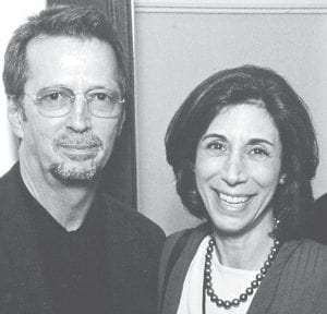 After the death of music publicist Ronnie Lippin from breast cancer in 2006, shown here with rock musician Eric Clapton, her husband established a partnership with the Tower Cancer Research Foundation to create an outreach program to educate those coping with cancer and their families and friends to help navigate the journey through cancer diagnosis and treatment. (AP Photo/Richard Lippin)