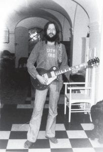 CLAPTON TAKES HONEST LOOK AT PAST -  In this undated photo released by Random House, a youthful Eric Clapton poses with a Gibson,