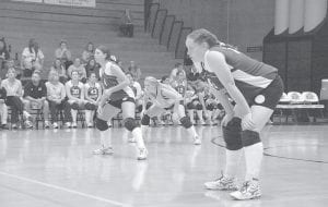 Letcher Central High School volleyball players (from left) Brittany Terry,Marquala Wolfe, and Heather Hatton were on the floor at Regents Hall at Northern Kentucky University for a state tournament match against Greenwood. The Lady Cougars lost, 25-5 and 25-8. (Photo by Chris Anderson)