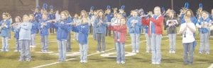 About 260 band students in grades five through 12 performed during halftime of the Letcher County Central High School football game on November 2. LCCHS band director Jason Griffith said 80 percent of those students have had less than a year of band lessons. Their performance was so popular among the crowd that the large band has been invited to perform again at this Friday night's play-off game at LCCHS. (Photo by Sally Barto)
