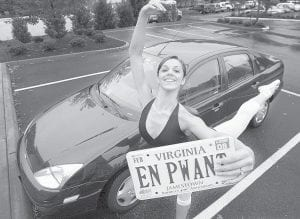 URSOVAIN -  Brittany Diaz did a pointe as she held her personalized license plate,