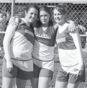 CROSS COUNTRY -  The Jenkins Middle High School boys' and girls' cross country teams recently participated in the Regional Cross Country Meet at Riverside. Members of the teams who qualified for the state meet are Hillary Brashear, Matthew Corbett, Sarah Corbett, and Katelyn Sexton. Pictured above are (left to right) Sarah Corbett, Hillary Brashear and Katelyn Sexton. Below are (left to right) Justin Wright, Matthew Corbett, and Eric Grimm.