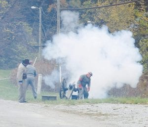 Richard Brown, Manton Cornett and Willis Strong, members of the Ben Caudill Camp No. 1629 of the Sons of the Confederate Veterans, performed an artillary salute during the Veterans Day appreciation program held in front of the Letcher County Veterans Memorial Museum in Whitesburg on November 10. The cannon is a Mountain Howitzer.