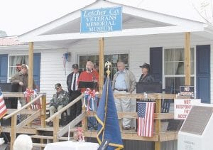 Whitesburg Mayor James W. Craft spoke at the Veterans Day appreciation program held Saturday morning at the Letcher County Veterans Memorial Museum. Letcher County Judge/Executive Jim Ward, Randall Caudill and Willie Webb are pictured in the background. Randall and Linda Caudill, of Jeremiah, have planned the Letcher County Veterans Day program for the past ten years.