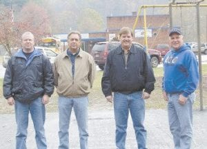 The basketball court located beside Beckham Bates Elementary School was recently blacktopped with funding from both the Letcher County Fiscal Court and the Letcher County Board of Education. Pictured from left is Letcher County Deputy Judge Eddie Meade, Magistrate Archie Banks, Letcher County Judge/Executive Jim Ward and Letcher County School Board Member Dr. Sam Quillen, Jr.