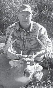 DEER HUNTER -  John Farmer killed this nine-point buck with a bow and arrow in Illinois.