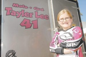 GIRLS CAN DO IT, TOO -  Tayler Adams, 9, has already been winning races on the motocross circuit for more than two years. (Photo by Earl Neikirk/Bristol Herald Courier)