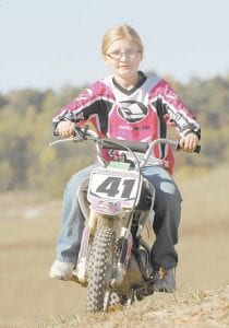 When Tayler Adams began racing motorcycles she would often get lapped by other riders. Now she's lapping them. (Photo by Earl Neikirk/Bristol Herald Courier)