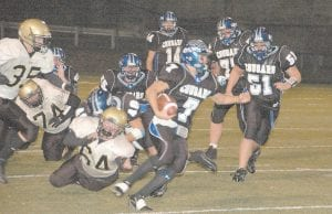 Letcher Central's Terry Tolson (7) broke free from Clay County's defense Friday. Other Cougars involved in the play were Josh McFall (55), Ben Fisher (40), Charlie Banks (14), David Adams (77), and Matt Chandler (51). (Photo by Chris Anderson)