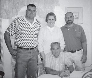 HOWARD FAMILY -  Ruby and Kern Howard of Fort Wayne, Ind., are pictured with their sons, Mike and Bill. Oma Hatton says,