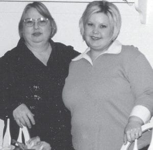 MOTHER AND DAUGHTER -  Nancy Oaks (left) and her daughter, Samantha Rice, are pictured at a 2005 Christmas party at the home of Sue Webb.