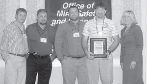 SAFETY AWARD -  Cumberland River Coal Co. Inc., Blue Ridge Mine is the winner of a 2007 surface mining safety award given by the Kentucky Coal Association and the Kentucky Department for Natural Resources Mine Safety and Licensing Office. The mine, located at Eolia, has two spreads of equipment and coal is mined from the A through J coal seams. The mine employs 97 people. Environmental Public Protection Cabinet Secretary Teresa Hill (right) presented the Surface Safety Award for the Hazard District to Cumberland River Coal Co. representatives (left to right) Leroy Mullins, Danny Webb, Kenny Spangler, and Michael Sargent.