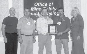 MINE SAFETY AWARD -  Enterprise Mining Co. LLC, Mine #5 is the winner of a 2007 underground mining safety award given by the Kentucky Coal Association and the Kentucky Department for Natural Resources Mine Safety and Licensing Office. The mine is located at Eolia. There are two active sections and continuous miners and shuttle cars are used to mine coal from the #4 coal seam. Fifty people are employed at the mine. Environmental Public Protection Cabinet Secretary Teresa Hill (right) presented the award for the Hazard District to Enterprise Mining Co., LLC representatives (left to right) Tim Balthis, John Collett, Mark Stamper, and Donald Pease.