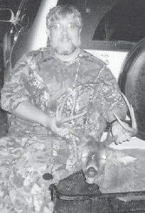 DEER HUNTER -  Mark Sturgill killed this eight-point buck on Nov. 18 near his home on Kingscreek.