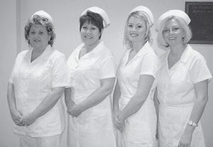 NEW NURSES -  Letcher County residents who have completed their practical nursing degree at Hazard Community and Technical College are (left to right) Lisa Caudill, Whitesburg; Gloria Dollarhide, Premium; Desirea Bowling, Whitesburg; and Lisa Williams, Whitesburg. A pinning ceremony for the graduates was held at the college on Dec. 12.