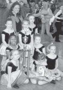 FIRST PLACE -  The Mini All-Star Team placed first in the jazz competition and best costume overall at the 15th annual Eastern High School Expo and Dance Competition held recently in Louisville. More than 50 teams competed in areas such as jazz, pom, and hip hop. Former Whitesburg High School and Pikeville College cheerleader Micca Watts coaches the Mini All-Star Team and the Shelby County High School dance team, which placed first in the lyrical division and third in the pom category. Shelby County also received the Spirit Award for sportsmanship. Watts is a second-grade teacher at Clear Creek Elementary in Shelby County. She is the daughter of Mike and Donna Watts of Roxana.