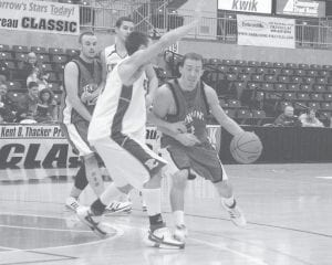DRIVING TOWARD THE HOOP -  Jenkins senior Eric Grim drove by the Pike County Central defense after getting a pick from teammate Nathaniel Wilder in the Kentucky Farm Bureau Classic tournament at the East Kentucky Expo Center in Pikeville. The Cavaliers lost the December 14 contest, 54-52. They rebounded on Monday night with a 49-39 win over Pound, Va. (Photo by Chris Anderson)