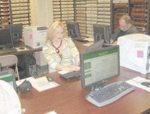 Deputy Clerk Lisa Maggard works on a new computer in the renovated Deeds Room in the Letcher County Courthouse.