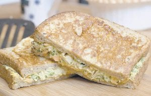 This Mediterranean inspired French Toasted Tuna and Hummus Sandwich is hearty enough to be a supper sandwich but still healthy thanks to substituting hummus for the mayonnaise and packing it with fresh vegetables. (AP Photo)