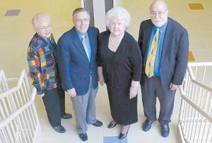 Pauline (Penny) Ritter Combs, second from right, poses with Southeast Kentucky Community and Technical College officials Judith Leonard, far left, and W. Bruce Ayers. At right is Eugene Meade, director of the Whitesburg Campus.