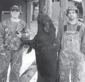 BOAR HUNTER -  This Russian boar was killed by Johnathan Sexton Dec. 29 at the wild boar hunt at Clarkrange Hunting Lodge in Tennessee. Pictured with the boar, which weighed more than 250 pounds, are Johnathan Sexton and Angie Sexton.