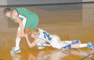 Eric Grimm of the Jenkins Cavaliers, left, and Devin Blair of Letcher County Central fought for control of a loose ball in a game played in Jenkins last week. (Photo by Chris Anderson)