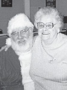 WITH SANTA -  Lourill Wood is pictured with Santa Claus at the Boone Fork Senior Citizens Center.
