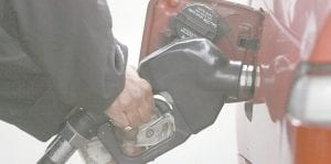 A gasoline attendant holds money in his hand while pumping gas in Portland, Ore. in this photo. Gas prices would increase up to 40 cents a gallon if Congress follows the advice of a special transporation commission. (AP Photo)