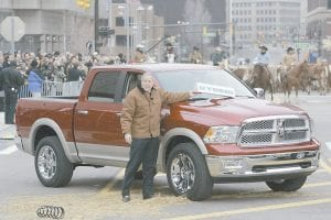 NEW RAM UNVEILED -  Jim Press, vice chairman and president of Chrysler, was photographed showing off the 2009 Dodge Ram at the North American International Auto Show in Detroit as cattle were being driven down a Detroit street (AP Photo)