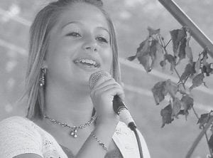Young and gifted singer Molly Slemp will sing coal mining songs at Letcher County Central High School on February 5.