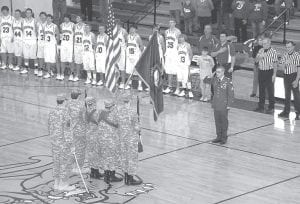 WELCOME HOME -  Army Sgt. Paul Michael Whitaker, who returned to his Cromona home recently after two tours of duty in Iraq, was honored before the Letcher Central vs. June Buchanan basketball game on Jan. 18. (Photo by Chris Anderson)