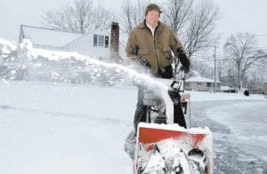 ELSEWHERE IN KENTUCKY -  Robert Palmer used a snow blower to remove snow from the parking lot of his business in May's Lick, Ky., yesterday (Tuesday). Letcher County escaped the bad weather that closed schools in nearby counties. (AP Photo/The Ledger Independent)