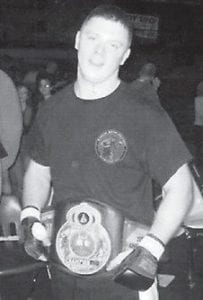 CHAMPION -  Chris Walker, son of Teresa and Scott Taylor, fought in the main event of the Gladiator Fighting Championship on Jan. 12 in Jenkins. He was trained by Eddie and Anthony Trotter in Seco. In a first round win, Walker earned the GFC light heavyweight division (205 pound weight class) belt.