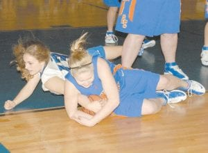 BATTLING -  Lady Cougar Lauren Thomas dove to floor to fight for a loose ball during Letcher Central's loss to Pike County Central on Monday night. (Photo by Chris Anderson)