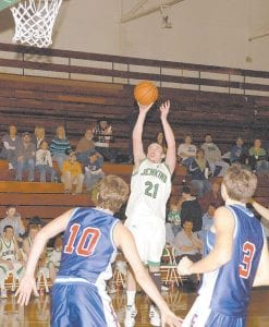 At left, Nathaniel Wilder (21) fires up a shot during the Cavaliers' 72-54 loss to Lee County. Wilder had 9 points.