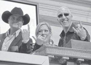 GONE COUNTRY -  Country singer John Rich, singersongwriter Carnie Wilson and Dee Snider, lead singer of Twisted Sister (left to right), posed on the New York Stock Exchange bell podium before ringing the closing bell Jan. 23. Rich is hosting a CMT cable channel show that includes Wilson and Snider. (AP Photo/Richard Drew)