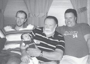 FOUR GENERATIONS -  Holding Audrey Mattison Maggard is her great-grandfather, Paul Maggard of Eolia. To his left is his son, Frankie Maggard of Blackey, who is Audrey's grandfather, and to his right is Audrey's father, Jason Maggard of McRoberts.
