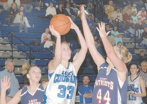 LEADING SCORER -  Brittney Sexton led the Letcher County Central Lady Cougars with 19 points in action against Knott County Central. (Photo by Chris Anderson)