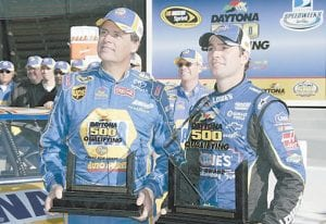 NASCAR drivers Michael Waltrip and Jimmie Johnson, right, posed for photos with the Front Row trophies after they finished Daytona 500 auto racing qualifications with the top speeds in Daytona Beach, Fla. (AP Photo/Terry Renna)